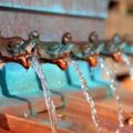 A woman was charged with Petty Theft after stealing coins from a fountain.